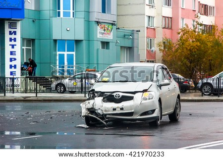 NOVYY URENGOY, RUSSIA - SEPTEMBER 9, 2015: Crashed motor car Toyota Auris in the city street. - stock photo
