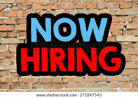 Now hiring On brick wall background - stock photo