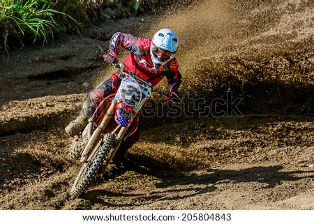 NOWOGARD, POLAND - JUNE 22 : Polish Western Zone Motocross Championship Round VII Poland, Nowogard  22 June 2014 - stock photo