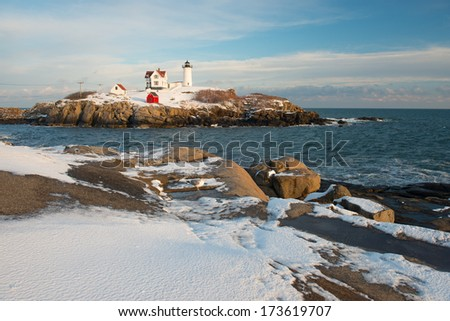 Nubble Lighthouse after a Winter Storm, Cape Neddick, York, Maine, USA - stock photo