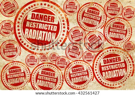 Nuclear danger background, red stamp on a grunge paper texture - stock photo