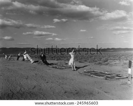 Nuclear 'Operation Cue' tested human ability to survive atomic bombs. These manikins at 7,000 feet from ground zero were part of thermal radiation test. April 4, 1955. - stock photo