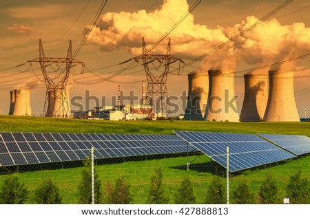 Nuclear power plant Dukovany with solar panels at sunset in Czech Republic - stock photo