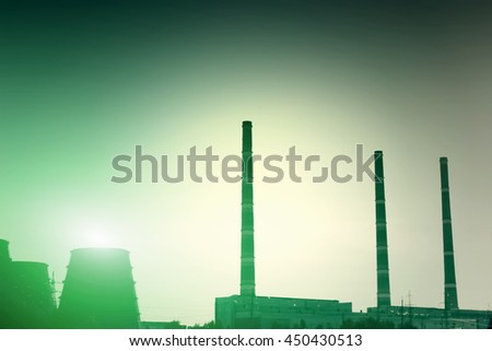 Nuclear power plant. Green toned - stock photo