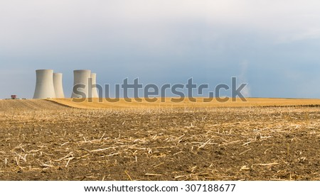 NUCLEAR POWER PLANT ON LANDSCAPE BACKGROUND - stock photo