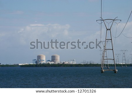 Nuclear power plant on the river with power lines - stock photo