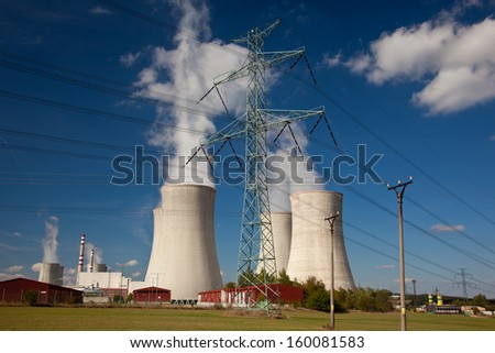 Nuclear power plant with transmission lines - stock photo