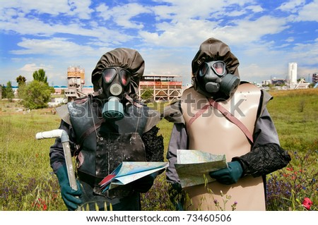 Nuclear protection crew in old protective suits and gas mask - stock photo
