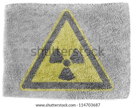 Nuclear radiation sign drawn on grey towel - stock photo