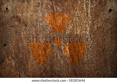 nuclear radiation sign on rusty metal texture - stock photo