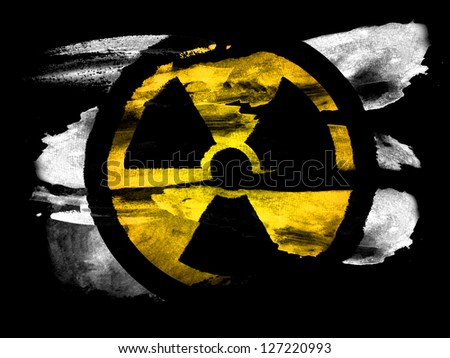 Nuclear radiation symbol   painted on black textured paper with watercolor - stock photo
