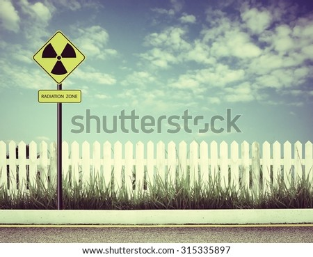 nuclear radiation warning symbol with blue sky  - stock photo