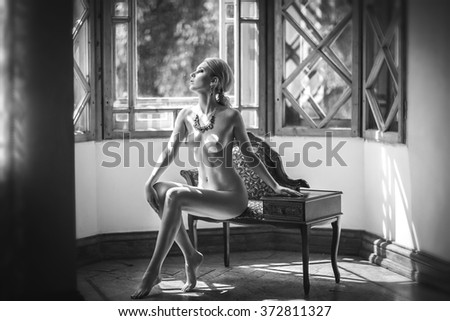 Nude, black & white photo, retro style, magazine,  advertising, model, ads, articles, interior, loggia, balcony, Windows, naked body, photo - stock photo