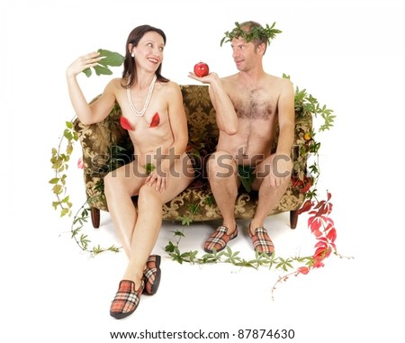 nude couple sitting on couch adam and eve concept - stock photo