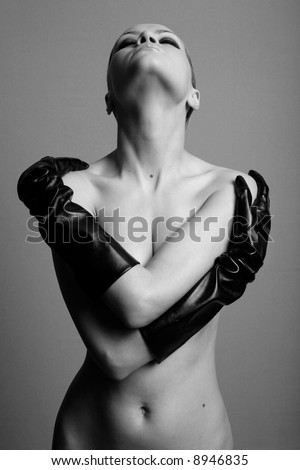 nude elegant girl with the gloves. Studio fashion photo. - stock photo