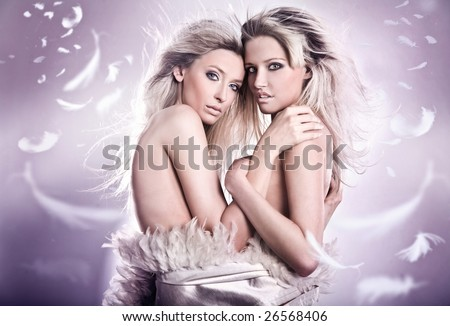 Nude portrait of two sensual young girls - stock photo