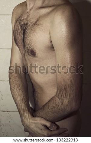 Nude wet body of a young man in the shower - stock photo