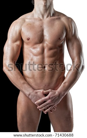 Nude wet muscular man torso on black white background - stock photo
