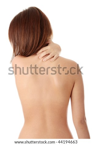 Nude woman from behind. Back pain concept. Isolated - stock photo