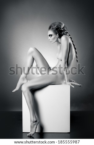 Nude woman posing in art style - stock photo