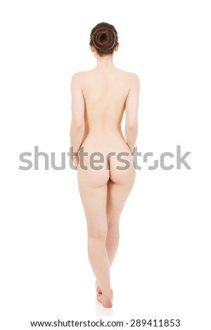 Nude woman standing back to camera. - stock photo