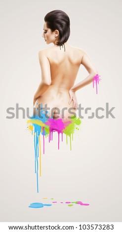 nude woman with varicoloured splatters - stock photo