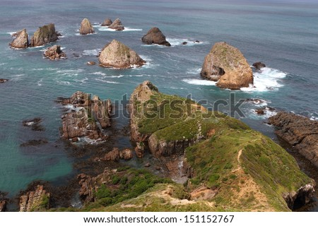 Nugget Point is one of the most iconic landforms on the Otago coast, New Zealand - stock photo