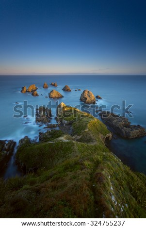 Nugget Points Lighthouse - stock photo