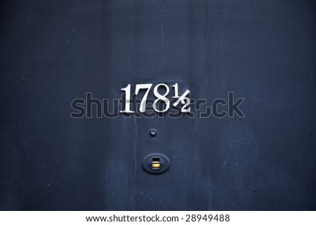 Number 178 and a half  on front door - stock photo