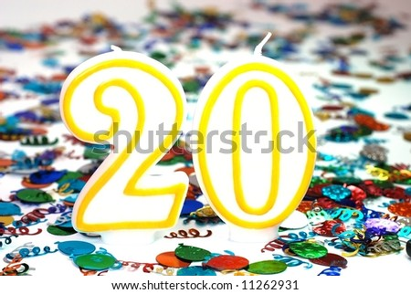 Number 20 celebration candle with confetti. - stock photo