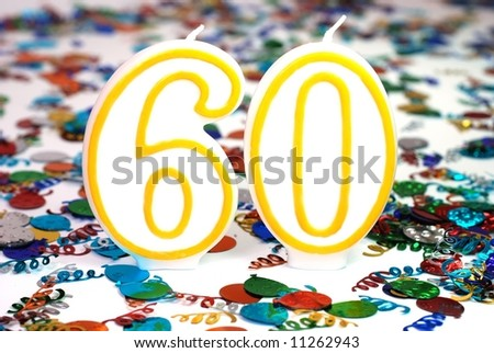 Number 60 celebration candle with confetti. - stock photo