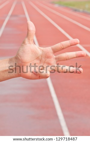 Number Four on Running Track Arena - stock photo