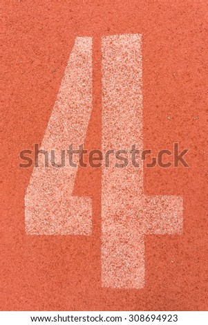 Number four on the start of a running track - check my portfolio for other numbers - stock photo