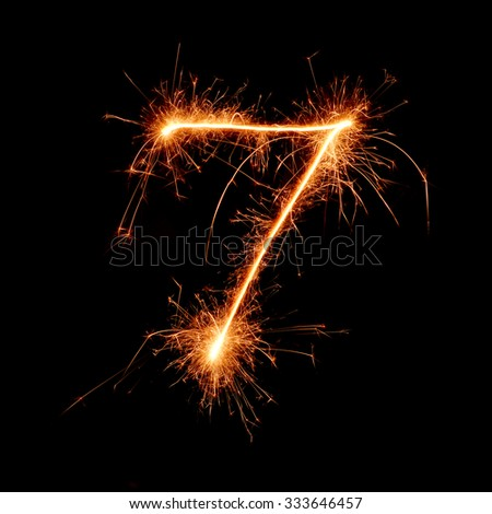 number from sparkler on black background - stock photo