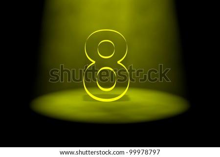 Number 8 illuminated with yellow light on black background - stock photo