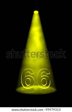 Number 66 illuminated with yellow spotlight on black background - stock photo