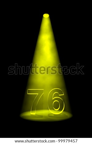 Number 76 illuminated with yellow spotlight on black background - stock photo