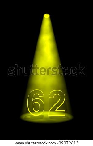 Number 62 illuminated with yellow spotlight on black background - stock photo