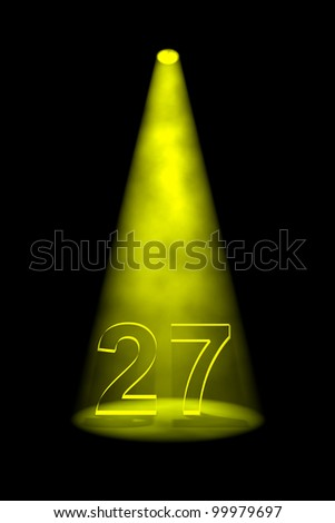 Number 27 illuminated with yellow spotlight on black background - stock photo