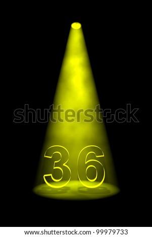 Number 36 illuminated with yellow spotlight on black background - stock photo
