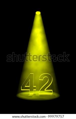 Number 42 illuminated with yellow spotlight on black background - stock photo