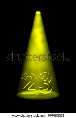Number 23 illuminated with yellow spotlight on black background - stock photo