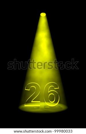 Number 26 illuminated with yellow spotlight on black background - stock photo