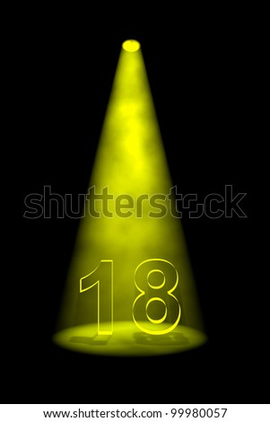 Number 18 illuminated with yellow spotlight on black background - stock photo