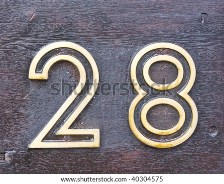 Number 28 in a wood plate - stock photo