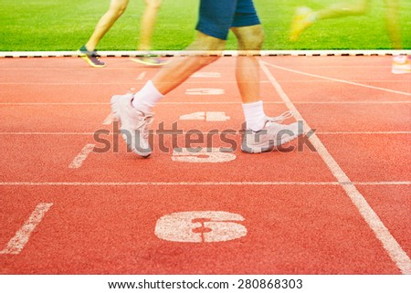 Number lanes track and athlete running on number lanes, Double exposure concept - stock photo