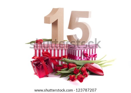 Number of age in a colorful studio setting and Dutch looking attributes like a clog wooden shoe and tulips - stock photo