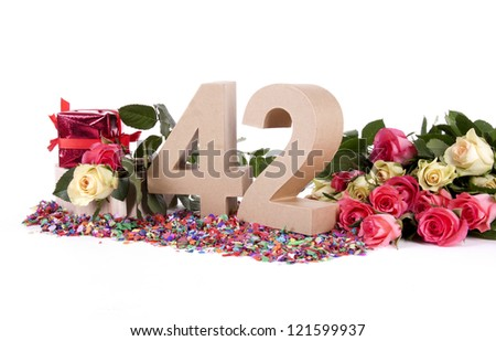 Number of age in a colorful studio setting with fresh roses on a bottom of confetti - stock photo