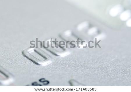 Number of silver Visa credit card close up shot  - stock photo