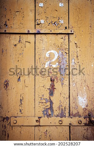 Number 2 on a wooden wall with some iron detail  - stock photo